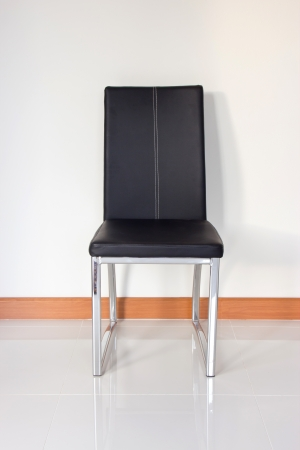 black leather chair over wall Stock Photo - 15124687