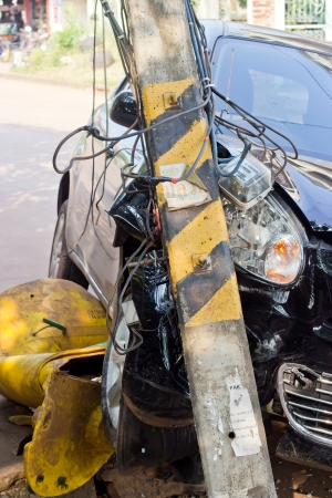 The image of car crashes into electricity pole