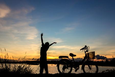 biker girl: Biker-girl at the sunset  at lake.