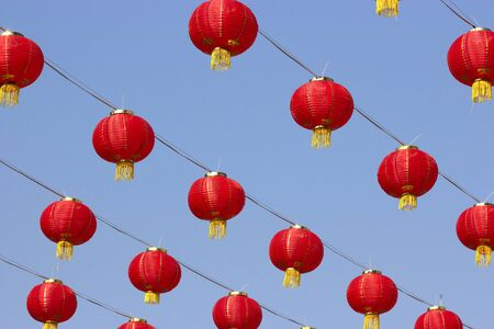Chinese red paper lantern or lamp decoration as ceiling for Chinese New Year Festival. Blue sky.