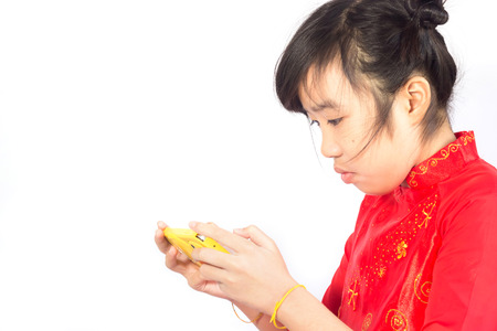 Asian girl using smartphone isolated on a white background Stock Photo