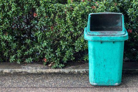 blue bin: Blue bin on pathway.