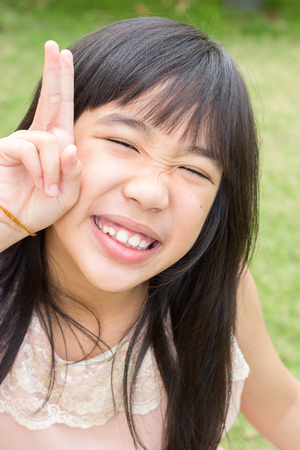 10 years: Cheerful 10 years cute asian girl. Stock Photo