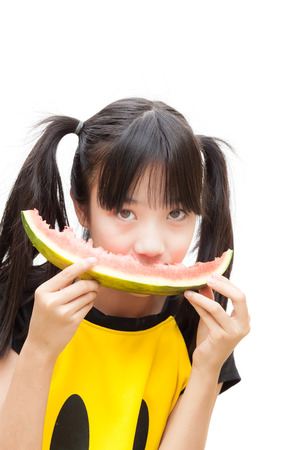 Asian girl holding and eating slice of watermelon, on white background. Stock Photo