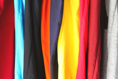 rolled up sleeves: Colorful t-shirts with rolled up sleeves on the hanger