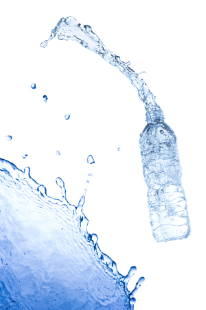 welling: Water splash out of bottle. Isolated on white background. Stock Photo