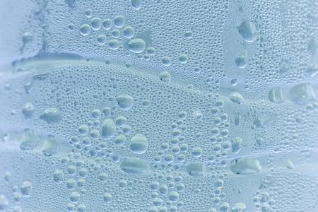 cerulean: Drops background, water drops on water bottle, cerulean blue color.