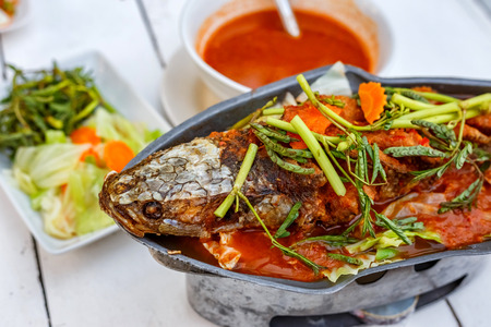 Fried Snake Head Fish Hot and Sour Soup