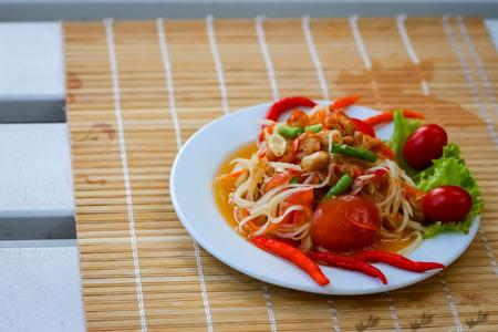 Closeup Papaya hot salad or what we called Somtum in Thailand