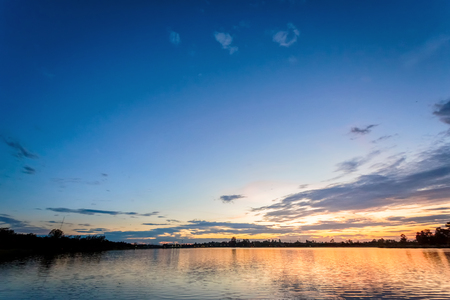 sunset sky with reflection on lake. Stock Photo