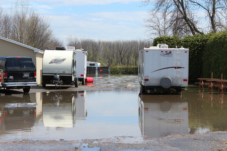 Flooded parking in St-Joseph du Lac, Quebec with campers parked on it. Taken May 6th 2017