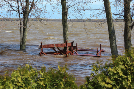 pooled: Flooded area in Pointe Calumet, Quebec, on May 6th, 2017. People attached their picnic tables to a tree, preventing them to be taken by the rising water.