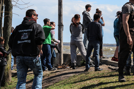 pooled: A crowd gathered in Pointe Calumet, Quebec, to watch the workers build a dam with sand, preventing water to go above the boat ramp.