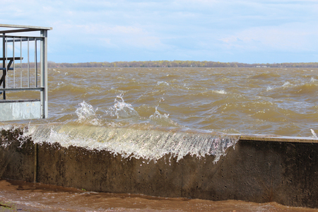 pooled: Water has risen from over 15 ft and is now passing over the dam at the Pointe Calumet Marina, which has never happened since the dam was built. May 6, 2017. Lake of Two Mountain flooding the area. Editorial