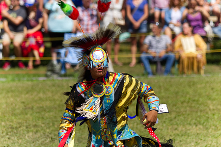 Kahnawake, Quebec, Canada - July 9, 2017: Pow Wow in Kahnawake Reserve for their 27th Annual Echoes of Proud Nation Pow Wow. Young man dancer with full regalia.