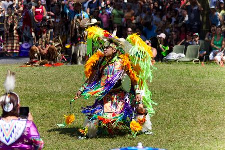 echoes: Kahnawake, Quebec, Canada - July 9, 2017: Pow Wow in Kahnawake Reserve for their 27th Annual Echoes of Proud Nation Pow Wow. Young man dancer with full regalia.