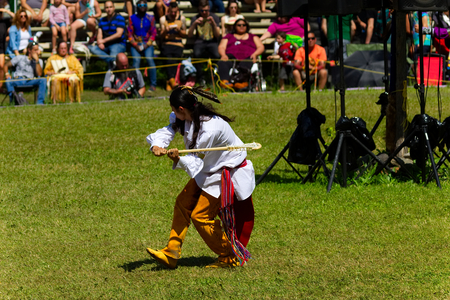 echoes: Kahnawake, Quebec, Canada - July 9, 2017: Pow Wow in Kahnawake Reserve for their 27th Annual Echoes of Proud Nation Pow Wow. Young man dancer