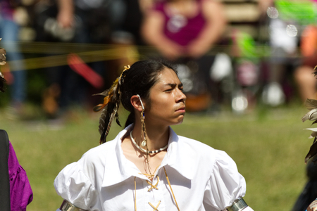echoes: Kahnawake, Quebec, Canada - July 9, 2017: Pow Wow in Kahnawake Reserve for their 27th Annual Echoes of Proud Nation Pow Wow. Proud young man dancer