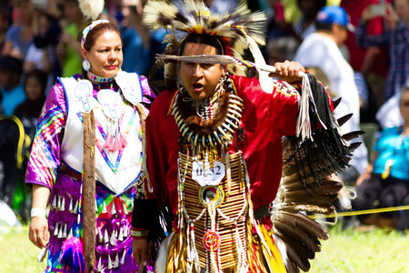 Kahnawake, Quebec, Canada - July 9, 2017: Pow Wow in Kahnawake Reserve for their 27th Annual Echoes of Proud Nation Pow Wow. Adult man dancer.