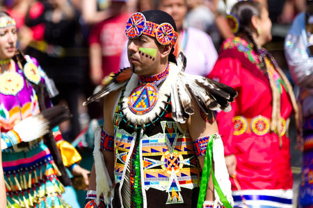 Kahnawake, Quebec, Canada - July 9, 2017: Pow Wow in Kahnawake Reserve for their 27th Annual Echoes of Proud Nation Pow Wow. Adult man dancer. Editorial