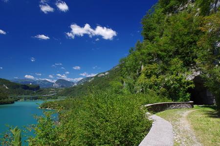 Quiet road with view on the lake of Cavazzo in Friuli Venezia Giulia, Italy