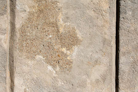 Old damaged weathered wall with fallen plaster - texture Stock Photo