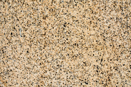 polychromatic: wall with polished polychromatic granite surface - texture, background Stock Photo