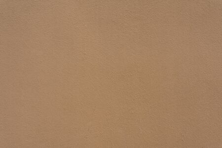 yellow  ochre: brown plaster wall for background or texture Stock Photo