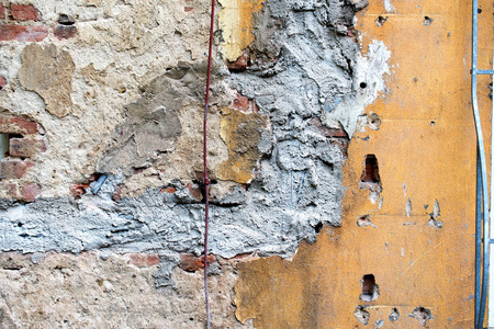 patched: damaged wall with patched, beige plaster, texture Stock Photo