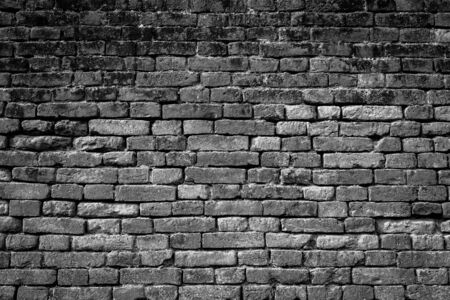 repaired: old repaired brick wall as a black-white background