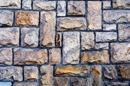 weathered stone cladded wall for background or texture