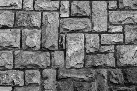 stone wall: weathered stone cladded wall for background or texture