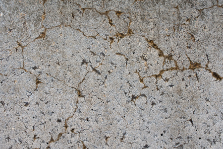 concrete wall with cracks and holes - texture, background Stock Photo