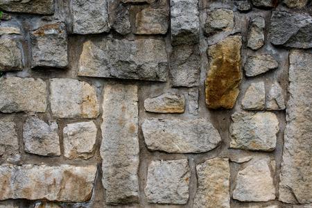 greece granite: massive wall of sandstone blocks - texture, background