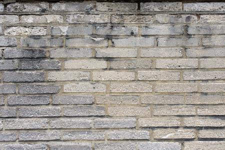weathered: Weathered wall of grey bricks for background or texture