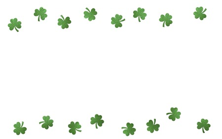 Paper clover leaves on the white background. Lucky shamrock, St.Patricks day holiday symbol. Space for text, top view.