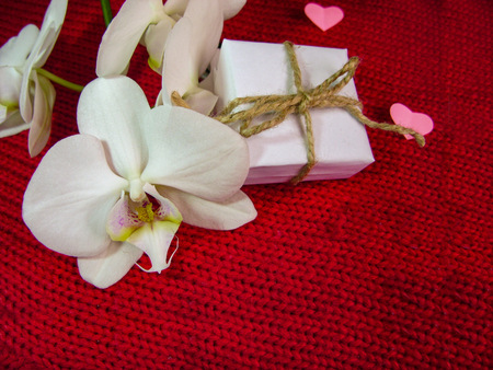 Orchid and hearts on red cloth, Valentines Day background, wedding day. 写真素材 - 119461226