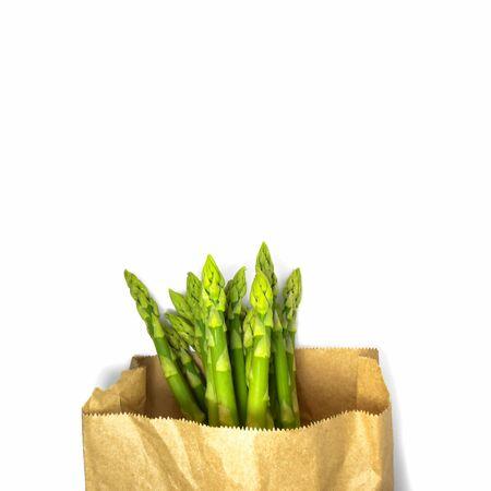 Raw asparagus in paper bag. Fresh green Asparagus.