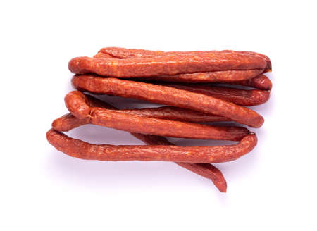 Smoked sausages. Hunting sausages on a white background. Top view. Stock Photo