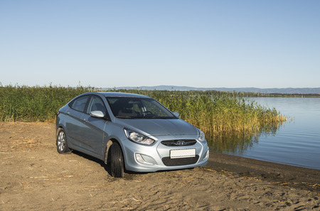 accent: Bashkortostan, Russia - August 3, 2015: The car is a Hyundai Accent on the lake. Editorial