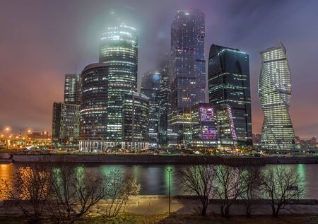 Moscow, Russia - November 6, 2015: business center Moscow City at night in the fog.