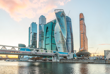 center city: Moscow, Russia - March 20, 2016: Pedestrian bridge Bagration in the background high-rise buildings of Business center Moscow city at sunset.