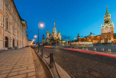 spasskaya: Moscow, Russia - March 14, 2016: the St. Basil Cathedral and Spasskaya tower in red square in the evening twilight.