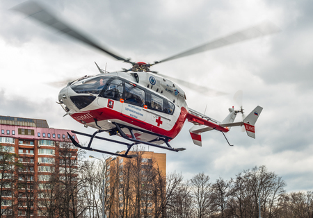 air transport: Moscow, Russia - April 11, 2016: the Medical helicopter takes off from the scene of a car accident at the Mozhaisk highway.