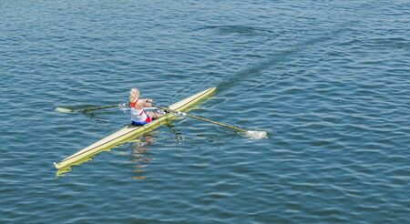woman squirt: A young girl is training on a kayak on the rowing channel in Moscow.