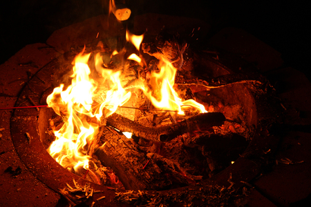smoldering: Fire Pit with Flames Burning Wood at Night Stock Photo