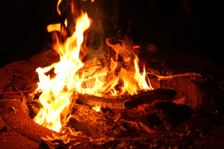 Fire Pit with Flames Burning Wood at Night Stock Photo
