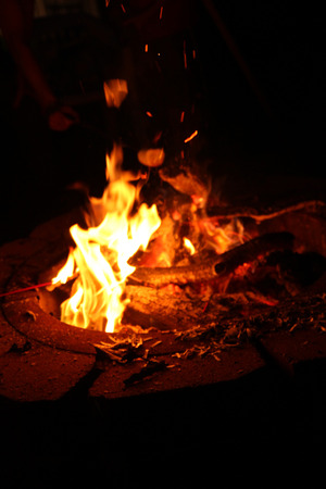 erupt: Fire Pit with Flames Burning Wood at Night Stock Photo