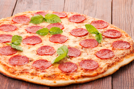 Tasty Pepperoni pizza with sausage from the top on white background Imagens