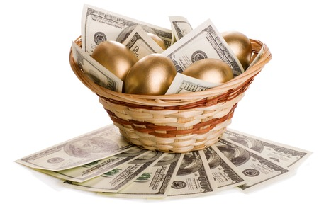 golden eggs and dollars in a basket isolated on white background 스톡 콘텐츠
